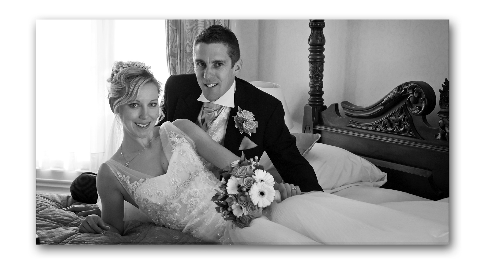 black and white wedding photo of bride and goom